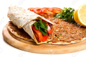 17197809-Turkish-specialty-pizza-with-parsley-and-lemon-Stock-Photo-lahmacun